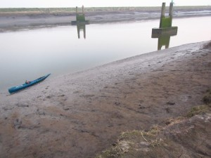 A horribly knee-deep muddy exit from the tidal river near King's Lynn.